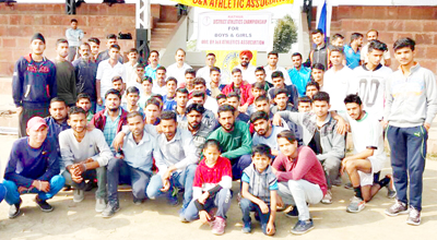Athletes posing for a group photograph at the concluding ceremony of District Kathua Athletic Meet.