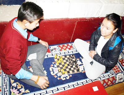 Players in action during Sullivan Cup chess tourney at Leh.