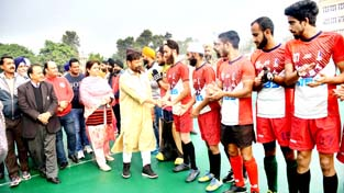 Minister for Forest, Ch. Lal Singh interacting with Hockey players at K K Hakhu Stadium in Jammu on Thursday.