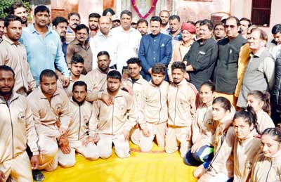 Selected J&K Wrestling team posing for a group photograph along with Minister for Food, Civil Supplies & Consumer Affairs in Jammu.