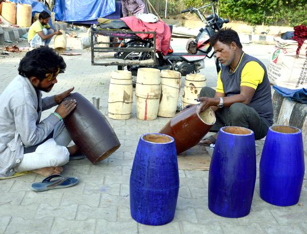 Workers preparing drums (Dholkis) ……-Excelsior/Rakesh