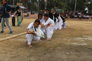 Young girls in action during Tug-of-War competition at Sports Festival in Reasi.