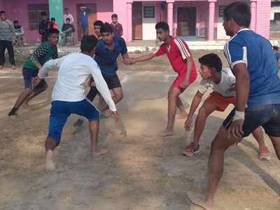 Raider in sight of securing a point while catchers watch during a Kabaddi match on Wednesday.
