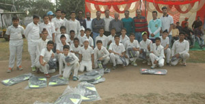 Budding cricketers posing for a group photograph along with chief guest Ramesh Mahajan and other dignitaries in Jammu on Thursday.