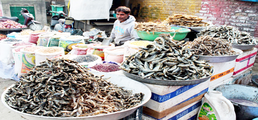 "Local dry fish, popularly known as ""Hukhgard"", hit the market with the onset of winter in Kashmir as a road side vendor looking for customers in down town Srinagar on Tuesday. (UNI)"