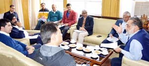 Finance Minister Dr Haseeb Drabu chairing a meeting at Jammu on Tuesday.