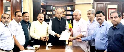 Union Finance Minister Arun Jaitley, in presence of Union Minister Dr Jitendra Singh, receiving a memorandum from a delegation of Federation of Industries Jammu, at North Block, New Delhi on Monday.