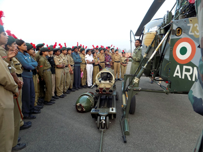 An officer of Aviation Wing of Army giving a demonstration on working of helicopter to NCC cadets at Nagrota.
