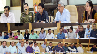 Div Com Dr Mandeep K Bhandari chairing a meeting at Reasi on Thursday.
