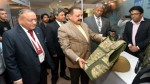 "Union Minister Dr Jitendra Singh going around the various exhibitions stalls during the 6th International Conference and Exhibition on ""Homeland Security"" at New Delhi on Friday."