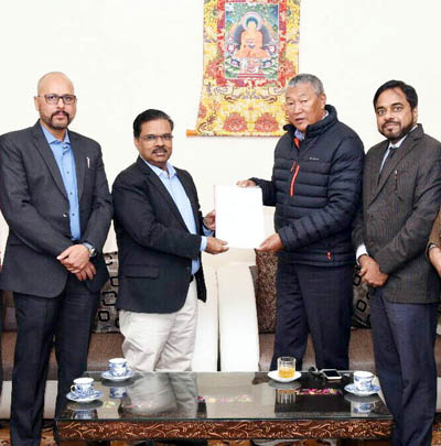 T Peethambaran, Head of Retail Business of BPCL in Northern Region, presenting LoI for a company's first Retail Outlet in Leh to Chering Dorjey, Minister for Cooperatives and Ladakh Affairs, in the presence of Rajesh Sharma, Territory Manager of BPCL in J&K.