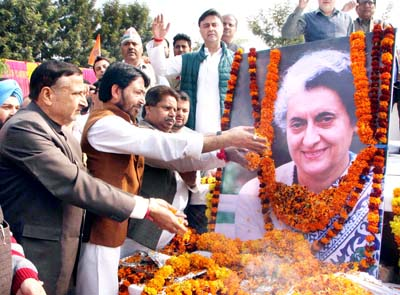 PCC chief G A Mir, senior leader Sham Lal and others paying floral tributes to Indira Gandhi at a function in Jammu on Sunday. -Excelsior/Rakesh