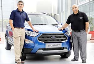 Anurag Mehrotra, president and MD, Ford India and Vinay Raina, Executive Director, Marketing, Sales and Service posing with new EcoSport at New Delhi.