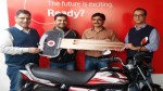 "Vodafone presenting the key of a Hero motorcycle to the ""Challenge to Win Season 19"" winner Pawan Sharma at Jammu on Thursday."