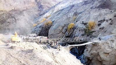 A portable steel bridge launched over Zanskar river by BRO. -Excelsior/Morup Stanzin