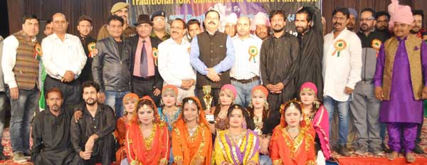 Minister for State for Finance and Planning Ajay Nanda possing for group photo with participants at inaugural function of 2-day cultural festival at Reasi on Saturday.