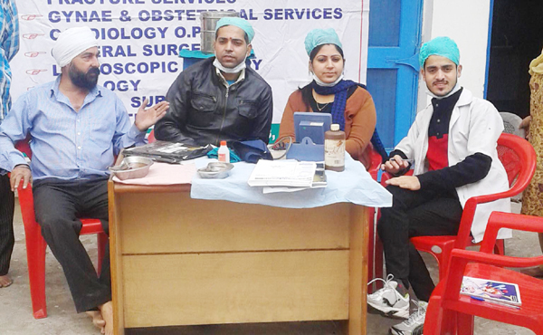 Doctors of SHS Memorial Hospital during a dental camp at Kalgi-Dhar Gurudwara, Rehari Colony in Jammu.