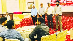 An official of Amul Plyboards addressing the contractors during a programme at Jammu.