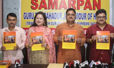 Film maker, Ashok Pandit, cine star Preeti Saproo and Kiran Wattal convener VKPS releasing a phamplet at Jammu on Tuesday. —Excelsior/Rakesh