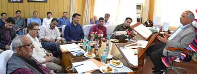 Revenue Minister, A R Veeri chairing a meeting at Jammu on Tuesday.
