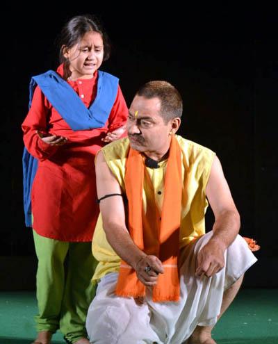 A scene of play 'Bawa Jitto' staged at Jhiri Mela in Jammu.
