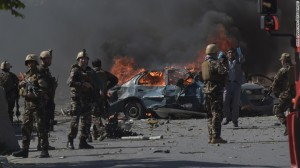 Death toll in Afghan funeral  attack jumps to 12: officials