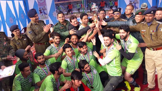 Winners of Football Tournament organized by CRPF posing for a group photograph alongwith a trophy in Bhaderwah.