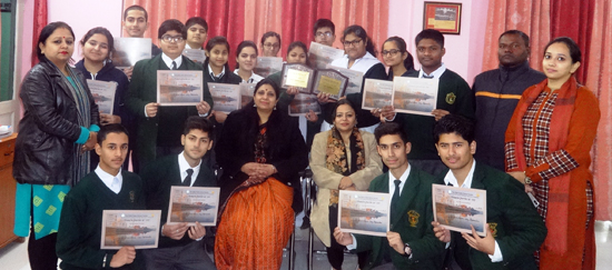 Winners of National Heritage Festival DPS students posing along with Principal and other dignitaries.