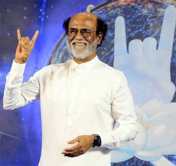 Actor Rajinikanth greeting his fans after confirmed his political entry during the last day of his photo shoot with his fans, in Chennai on Sunday. (UNI)