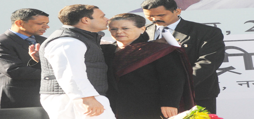 Newly elected Congress president Rahul Gandhi kissing his mother and outgoing party president Sonia Gandhi after her address to the partymen, in New Delhi on Saturday. (UNI)