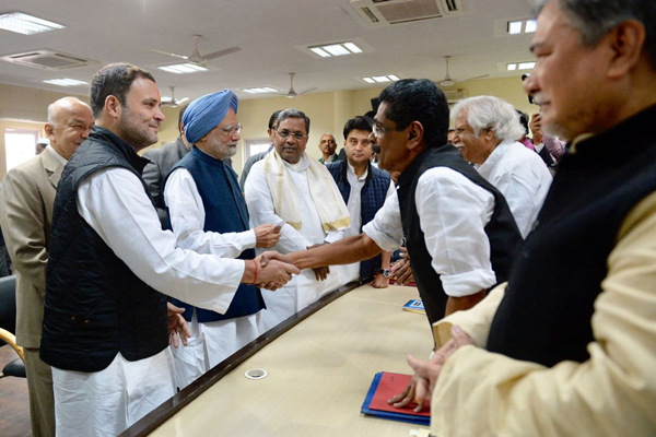 Congress vice president Rahul Gandhi with former Prime Minister Manmohan Singh and other senior party leaders filing his nomination papers for the election of Congress president in New Delhi on Monday. (UNI)