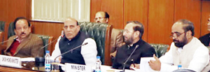 Union Home Minister Rajnath Singh chairing inter-ministerial meeting on development issues in J&K and other States at New Delhi on Friday.