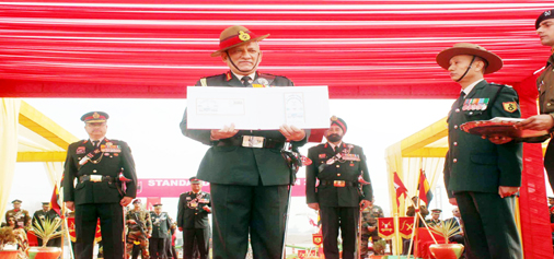 Chief of Army Staff, Gen Bipin Rawat releasing the first day cover on the occasion of Standard Presentation to the Armoured Regiments at Suratgarh Military Station in Rajasthan on Tuesday. (UNI)