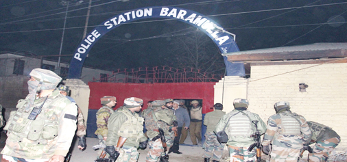 Security personnel outside Baramulla police station after attack by the militants on Saturday. —Excelsior/Aabid Nabi