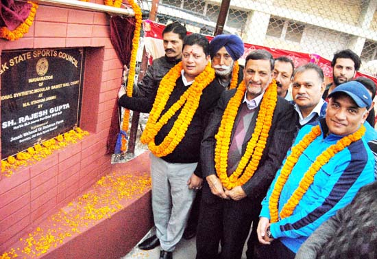MLA Jammu East Rajesh Gupta and other dignitaries inaugurating synthetic turf at Basketball court in Jammu.