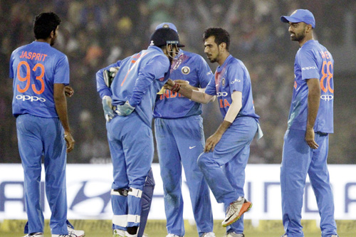 Yuzvendra Chahal celebrating dismissal of Sri Lankan batsman with his teammates in T-20 at Cuttak.