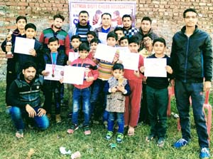 Winners of Kathua District Chess Championship posing for group photograph with dignitaries.