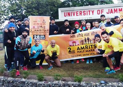 Jammu Runners posing after Promo Run at Jammu University on Sunday.