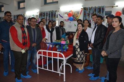 Dr Sunanda Raina, Principal, GMC Jammu, presenting gift to a child in pediatric oncology ward in SMGS Hospital, Jammu.