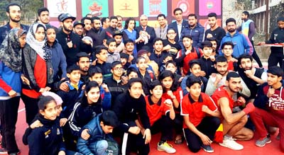 Winners of Wushu Championship posing along with the chief guest, Dr Ashok Bhan and other dignitaries in Jammu on Saturday.