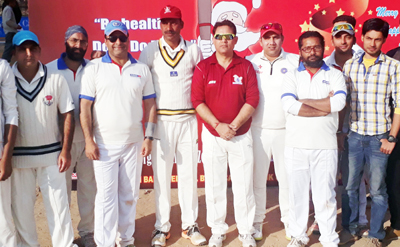 Players posing along with the chief guest during a match of Christmas Cup in Jammu.