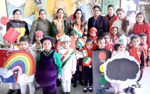 Children posing along with dignitaries during Inter-School competition at JK Montessorie British School.