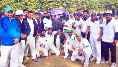Players of Media-XI Cricket Club Jammu and PDD-XI posing for group photograph.