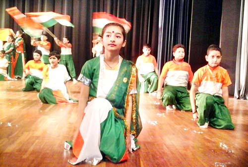 Students of KC Gurukul presenting colourful cultural item while celebrating Annual Day.