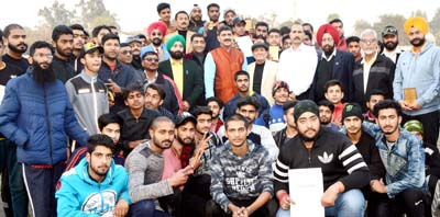 Athletes posing for a group photograph during concluding ceremony of 15th J&K State Athletics Championship.