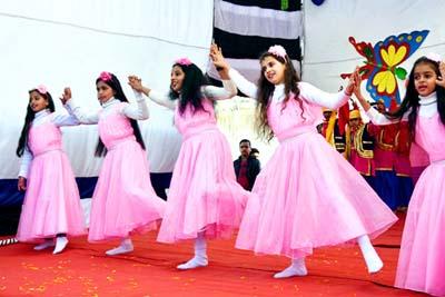 Children presenting cultural item during Annual Day celebration at APS Dhar Road, Udhampur.