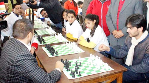 Secretary J&K State Sports Council, Waheed-ur-Rehman Parra testing chess skills while inaugurating historic Chess Premier League in Jammu. -Excelsior/Rakesh