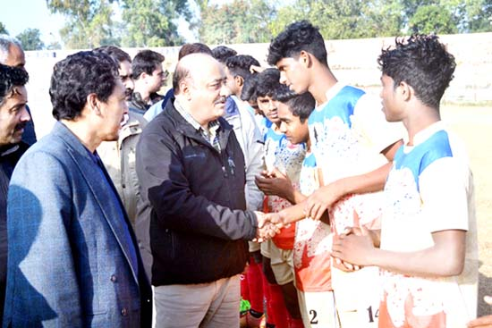Director Sports, Sheikh Fayaz Ahmed interacting with young footballers during 63rd National School Games at MA Stadium in Jammu.