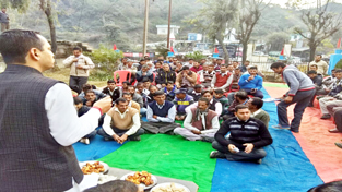 MLA R S Pathania addressing PHE workers on Sunday.