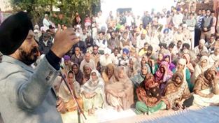 Cong leader Manjit Singh addressing public gathering in Vijaypur on Sunday.